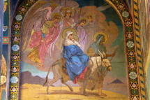 Mosaic of Joseph and Mary and baby Jesus riding on a donkey, the flight into Egypt