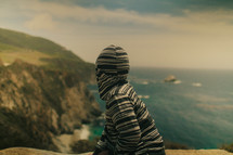 A boy with a hoodie overlooking the world | Dreams | Vision | Next generation
