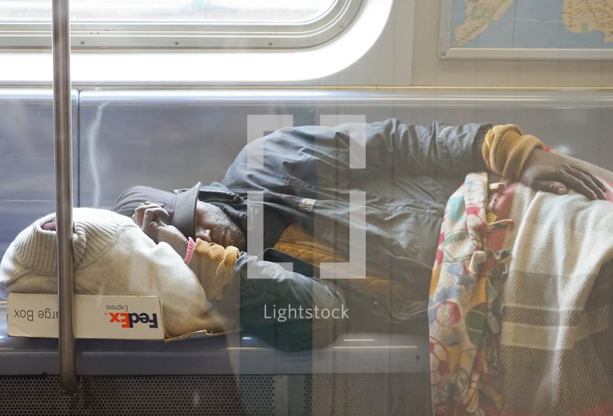 a man sleeping on a train
