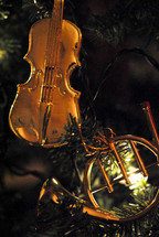 Christmas tree ornaments; violin and French horn.