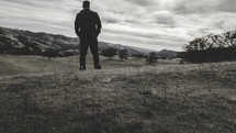 man facing forward outdoors
