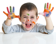 toddler with paint on his hands
