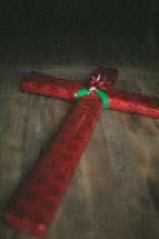 cross wrapped in Christmas wrapping paper