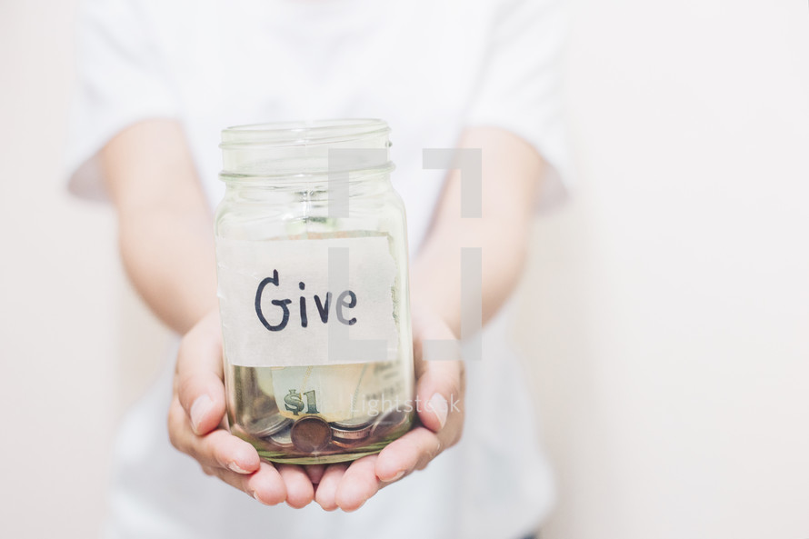 cupped hands holding a giving jar