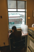 man working at a cubicle