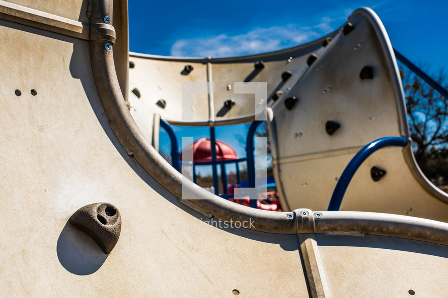 grips on a climbing wall at a playground