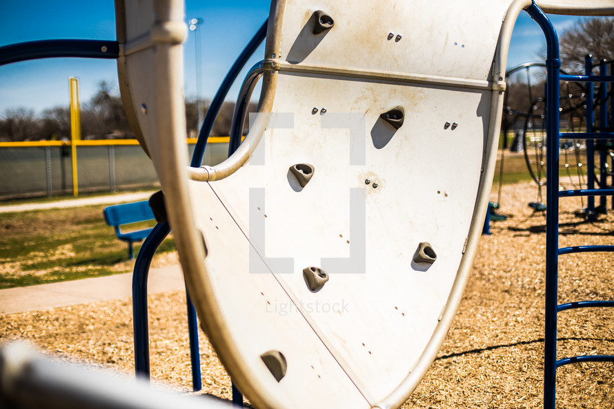 grips on a climbing wall on a playground