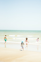children running on a beach