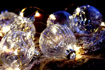 clear glass ornaments and fairy lights