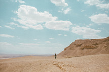 a woman walking in a desert in Israel