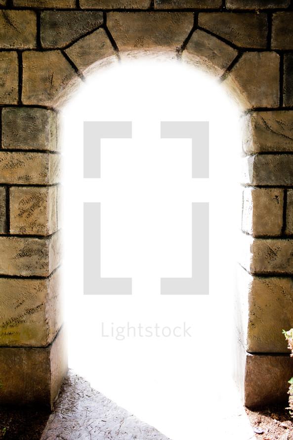 light through an arched doorway