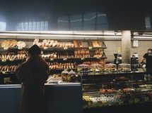 a woman shopping at a bakery
