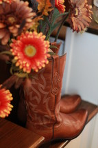 gerber daisies in cowboy boots