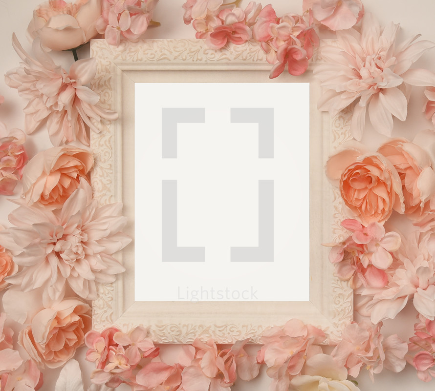 pink flowers around a white frame