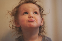 toddler girl with a silly face