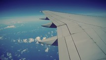 Airplane wing in flight.