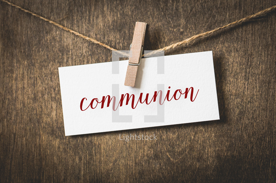 word communion hanging on a clothesline