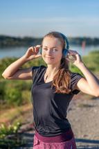 teen girl wearing headphones on a jog