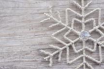 snowflake decoration on wood background