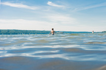 boy child wading in water