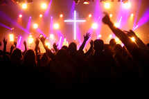 raised hands of an audience at a Christian music festival