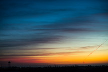 Colors of a sunset stretch across the horizon.
