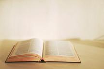 open Bible in the corner of an empty room