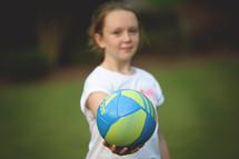 girl child holding a soccer ball