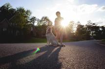 a little girl walking her dog