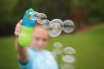 blowing bubbles outdoors