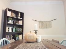 hello fall pumpkin centerpiece on a dinning room table