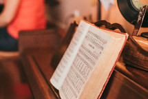 Hymnal on an old piano