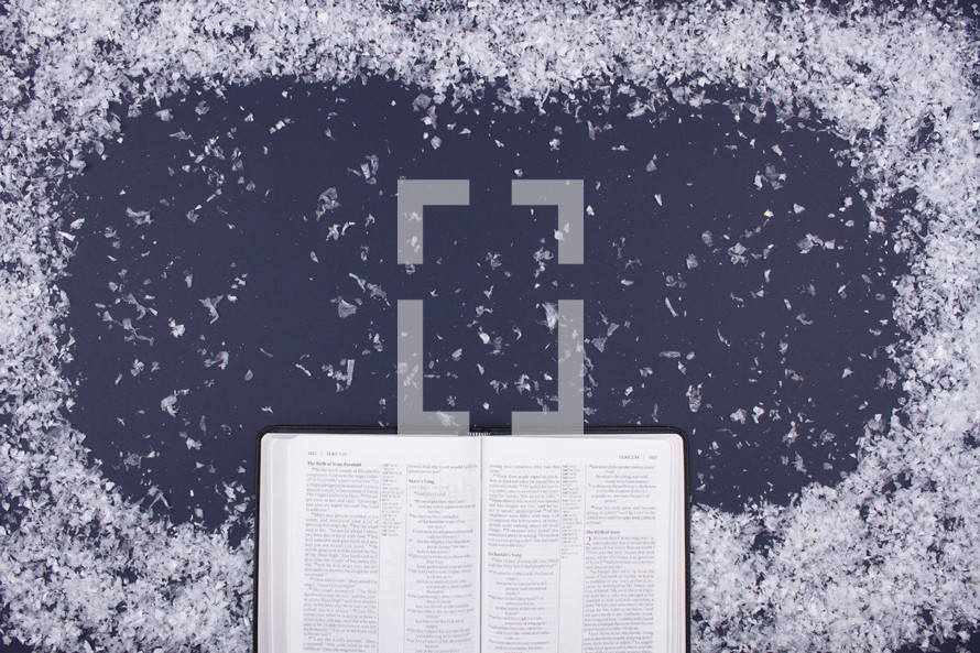 snow border and open Bible