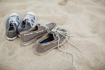 sneakers in the sand at a beach