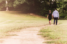 couple walking outdoors holding hands