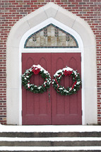 Christmas wreaths on a church's doors