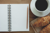 croissants, coffee, and notebook