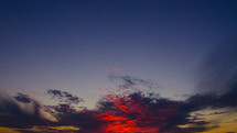 red and purple clouds in the sky at sunset
