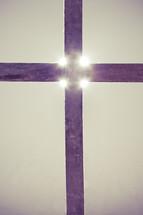 glow of light on a cross