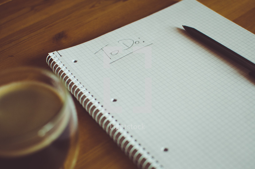 to do list and pen and drink