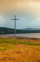 cross on a lake shore