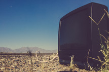 TV sitting in an empty field