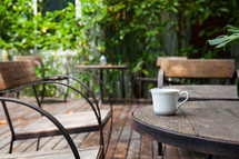 coffee mug on a wooden table outdoors