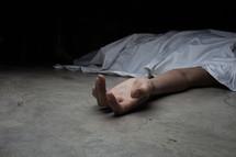 a dead body under a sheet