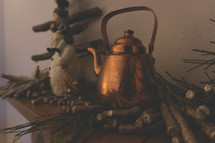 brass kettle on a mantle