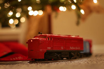 toy train under a Christmas tree