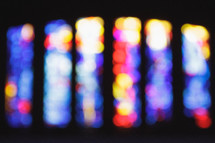 blurry image of stained glass windows