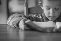 boy child reading a Bible