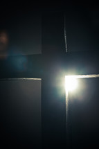 spotlight shining on a cross