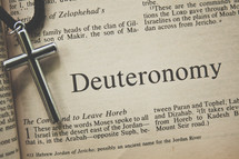 Deuteronomy and a cross necklace